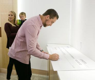 Adam Thielen signs $100,000 Thielen Foundation Pledge Check